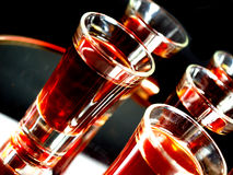 Alcohol glasses. On a mirror Stock Image