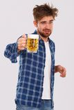Alcohol. Guy in blue shirt with beer Royalty Free Stock Photography