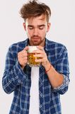 Alcohol. Guy in blue shirt with beer Royalty Free Stock Image