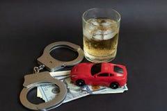 Alcohol, handcuffs en autostuk speelgoed op kleurenachtergrond royalty-vrije stock afbeeldingen