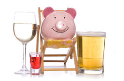 Alcohol on holiday piggy bank Stock Images