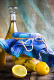 Alcohol jar quince liqueur sliced fruit prepare wooden setting Royalty Free Stock Photography