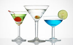 Alcohol line up. Three glass of alcohol drinks against white Stock Images