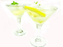Alcohol liqueur cocktail with lemon and ice Royalty Free Stock Photo