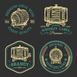Alcohol logos.Wooden barrels set with drinks signs of cognac,brandy,whiskey,wine,beer.Labels, badges with sketched kegs. Alcohol logos. Wooden barrels set with stock illustration
