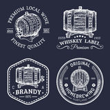 Alcohol logos.Wooden barrels set with drinks signs of cognac,brandy,whiskey,wine,beer.Labels, badges with sketched kegs. Royalty Free Stock Images