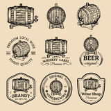 Alcohol logos. Wooden barrels set with drinks signs of cognac,brandy,whiskey,wine,beer. Labels with hand sketched kegs. Stock Image