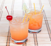 Alcohol margarita cocktails or long island Iced tea with lime in Stock Photos