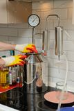 Alcohol mashine. Cooking home-brew royalty free stock photography