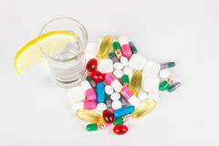 Alcohol and medicals on white. Dangerous mix of alcohol and medicals on white Royalty Free Stock Image