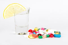Alcohol and medicals on white Royalty Free Stock Photography