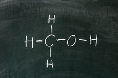 Alcohol. Methanol on blackboard in chemistry class royalty free stock images