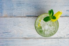 Alcohol mojito cocktil bar long drink fresh tropical beverage top view copy space highball glass, with rum, spearmint Royalty Free Stock Photo