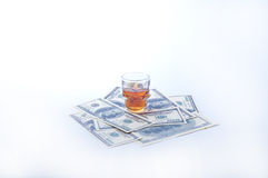 Alcohol and money Royalty Free Stock Photo