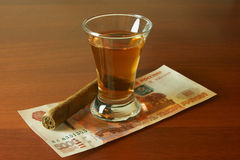 Alcohol, money and a cigar Stock Image