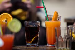 Alcohol orange daiquiri and cuba libre cocktail Stock Photos