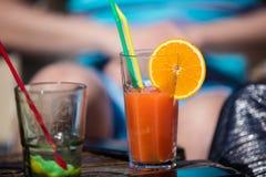 Alcohol orange daiquiri and mint cocktail Stock Photos