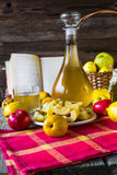 Alcohol quince liqueur sliced fruit prepare wooden setting Stock Photography