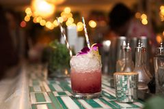 Alcohol refreshing cocktail with ice, liquor and juice in nightclub or bar counter royalty free stock image