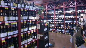 Alcohol on shelves selling at supermarket Stock Photo