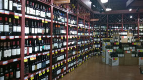 Alcohol on shelves selling at supermarket Royalty Free Stock Image