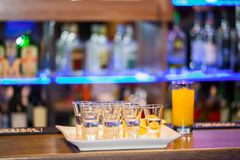 Alcohol shots on the bar. Alcohol in shots glasses on the bar Royalty Free Stock Image