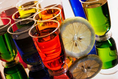 Alcohol shots with reflection Stock Images