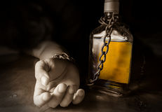 Alcohol slave or Alcoholism. Social problem Royalty Free Stock Images