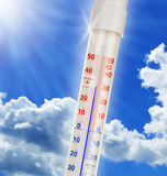 Alcohol thermometer over blue sky Royalty Free Stock Photography