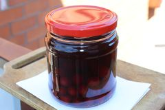 Alcohol. Tincture of cherries in the moonshine. The tincture of cherries in the moonshine. Alcohol. red glaass royalty free stock photos