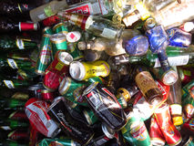 Alcohol Trash. A background of thrash of alcohol bottles and cans lying in the outdoors Stock Photos