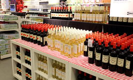 Wine retail shop store supermarket. Alcohol wine in beverage department in supermarket. Alcohol and wine on sale on display stand interior retail store shop stock photo