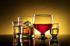 Alcohol - Wine, Whiskey and Shot Glasses royalty free stock photo