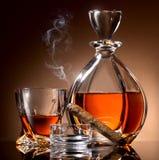 Alcohol y cigarro Foto de archivo libre de regalías