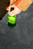 Alcoholic. The underage with an alcohol bottle in hand Stock Images