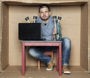 Alcoholic asks for help. Man in the box Royalty Free Stock Photo