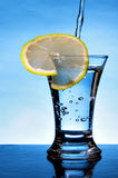 Alcoholic beverage with lemon slice Stock Image