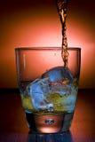 Alcoholic beverage whith ice cubes Stock Image