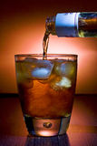 Alcoholic beverage whith ice cubes. Glass of alcoholic beverage whith ice cubes Royalty Free Stock Photography
