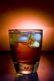 Alcoholic beverage whith ice cubes Royalty Free Stock Images