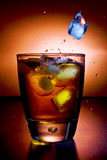 Alcoholic beverage whith ice cubes Stock Photos