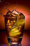Alcoholic beverage whith ice cubes Royalty Free Stock Photo