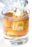Alcoholic beverage whith ice cubes. Isolated over white Royalty Free Stock Photography