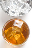 Alcoholic beverage whith ice cubes. Isolated over white Stock Photos