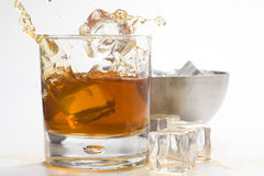 Alcoholic beverage whith ice cubes Stock Photos
