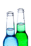 Alcoholic beverages isolated on white. Alcoholic beverages - wet bottles with blue and green liquid isolated on white Stock Photos