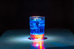 Alcoholic blue cocktail is in glass, on the bar Stock Photography