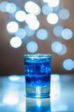 Alcoholic blue cocktail is in glass, on the bar Royalty Free Stock Photo