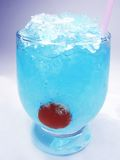 Alcoholic blue curacao cocktail with cherry Stock Photo