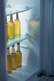 Alcoholic bottles arrange in refrigerator Royalty Free Stock Photos